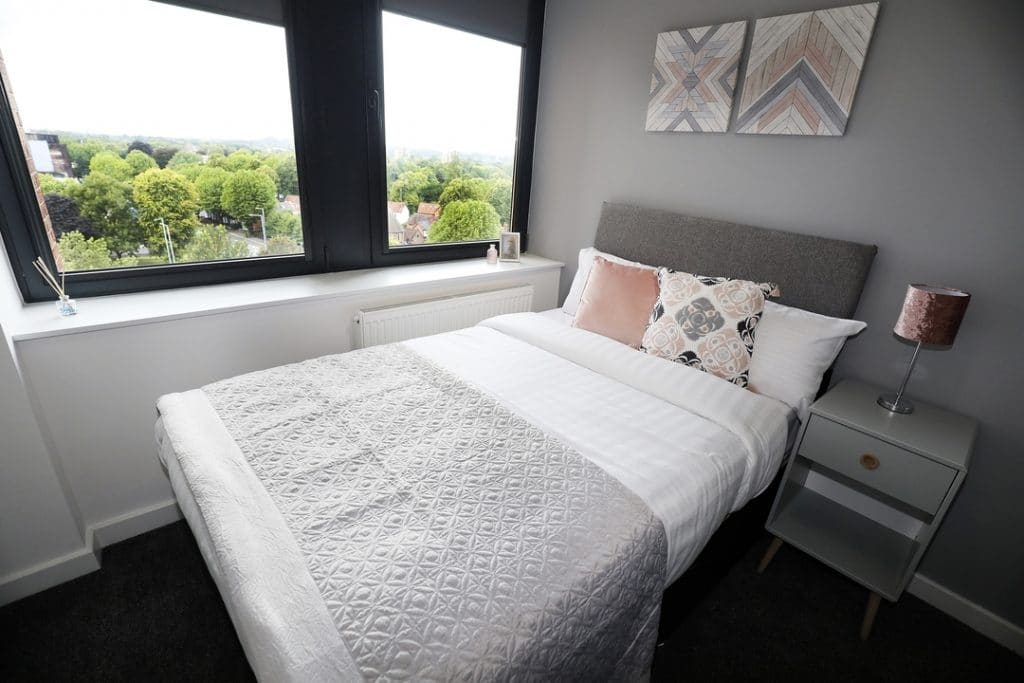 Pink, Grey and White Bed in Studio
