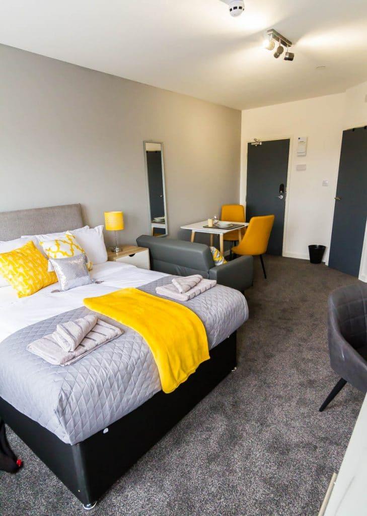 studio flat Wolverhampton with grey and yellow decor