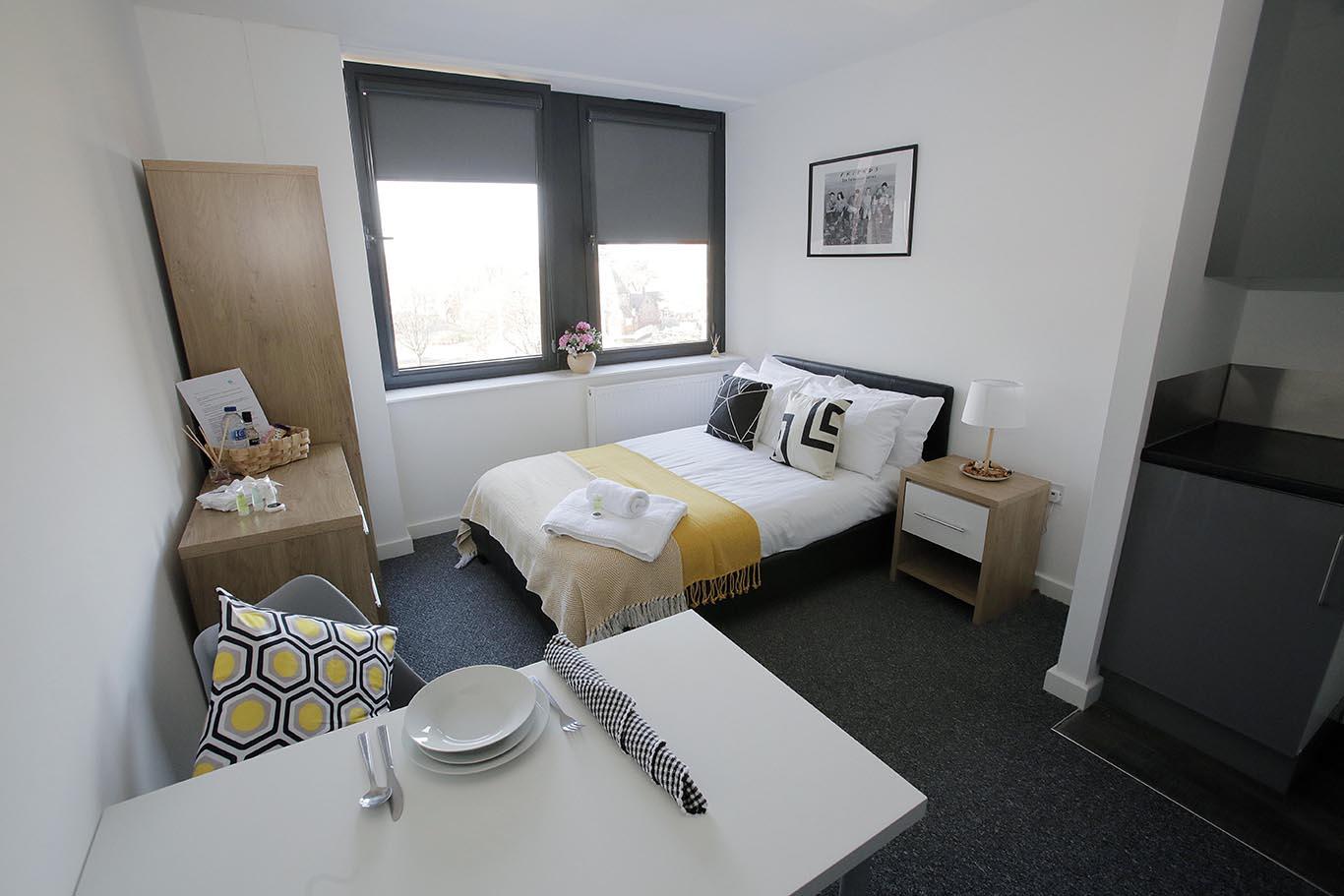 Yellow, Grey, Black and White Studio Apartment