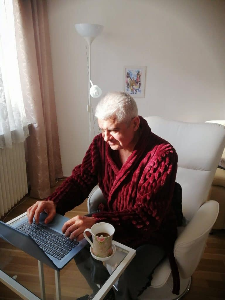Man working in dressing gown