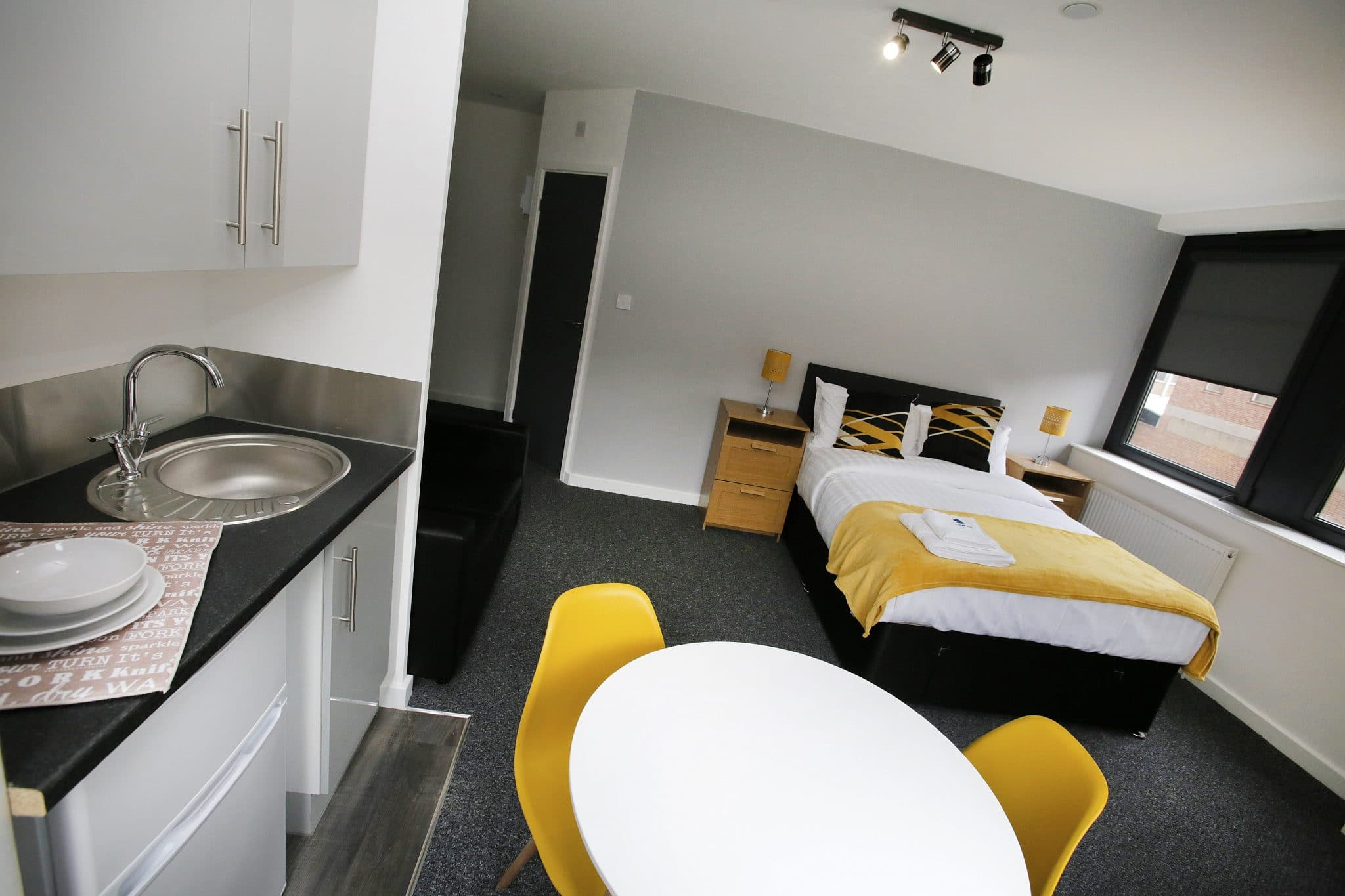 Black and Yellow Studio Apartment