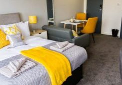 studio flat Wolverhampton with grey and yellow decor